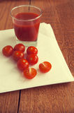 Fresh tomato juice a glass and cherry tomatoes royalty free stock photography