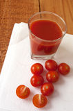 Fresh tomato juice a glass and cherry tomatoes Royalty Free Stock Photo