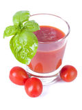 Fresh tomato juice with basil royalty free stock photography