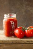 Fresh tomato juice in a glass jar Royalty Free Stock Images
