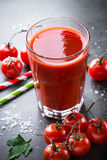 Fresh tomato juice. And ingredients at dark slate table. Vertical Royalty Free Stock Photography