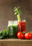 Fresh tomato juice and juice of spinach, celery (smoothies). Detox and healthy food stock photo