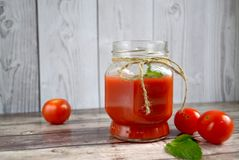 Fresh tomato juice,. Mint is on a table Royalty Free Stock Photography