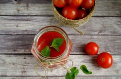 Fresh tomato juice,. Mint is on a table Royalty Free Stock Photos
