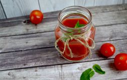 Fresh tomato juice,. Mint is on a table Royalty Free Stock Image