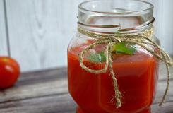 Fresh tomato juice,. Mint is on a table Royalty Free Stock Photo