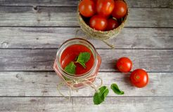 Fresh tomato juice,. Mint is on a table Stock Images