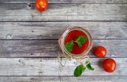 Fresh tomato juice,. Mint is on a table Stock Photography