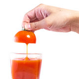 Fresh tomato juice pouring into glass Stock Images