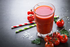 Fresh tomato juice. With salt and ingredients at dark slate table Stock Photos