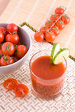 Small tomato juice Royalty Free Stock Photos