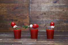 Fresh tomato juice with small snack with tomato and feta cheese Stock Photos