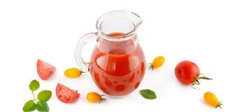 Fresh tomato juice and tomatoes isolated on white background. Fl Royalty Free Stock Photos
