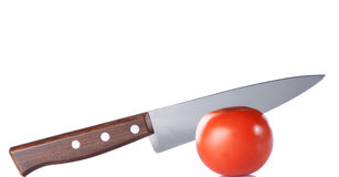Fresh tomato and knife isolated on white Stock Images