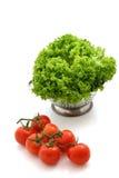 Fresh tomato and lettuce. On white background Stock Photo