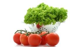 Fresh tomato and lettuce. On white background Royalty Free Stock Photo