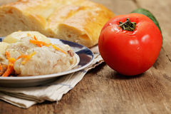 Fresh tomato and meal Stock Photos