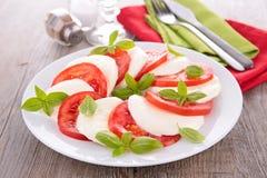 Tomato and mozzarella salad. Fresh tomato and mozzarella salad Royalty Free Stock Images