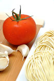 Fresh tomato, noodle and garlic Stock Images