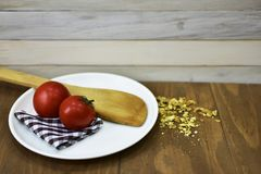 Fresh tomato oats kitchen cloth spoon wooden rustic food breakfast healthy organic Stock Image
