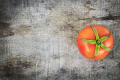 Fresh tomato on old wood. The scientific name of tomato is Lycopersicon Esculentum Mill royalty free stock images