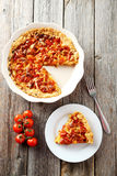 Fresh tomato pie on a grey wooden background Stock Image