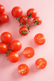 Fresh tomato. On pink background with drops of dew Royalty Free Stock Photos