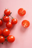 Fresh tomato. On pink background, top view Stock Photography