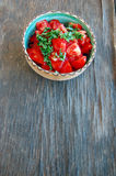 Fresh tomato salad with basil in ceramic bowl Royalty Free Stock Images
