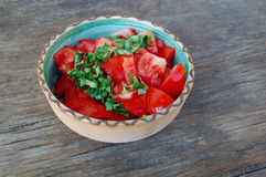 Fresh tomato salad with basil Stock Photo