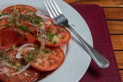 Fresh Tomato Salad. Delicious argentinian stake with grilled vegetables and empanadas Royalty Free Stock Photos