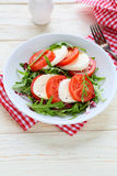 Fresh tomato salad with mozzarell Stock Images