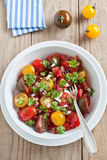 Fresh tomato salad. With onion and parsley Stock Photos