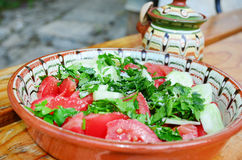 Fresh tomato salad in traditional bulgarian plate Stock Image