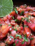 Fresh tomato salsa with lime Stock Photos