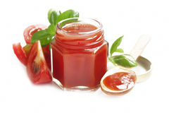 Fresh tomato sauce with basil isolated on white Royalty Free Stock Photography