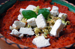 Fresh tomato sauce with basil leaves and goat cheese Stock Photography