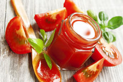 Fresh tomato sauce with basil on wooden table Stock Photos