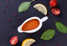 Fresh tomato sauce in the white sauce boat Royalty Free Stock Image