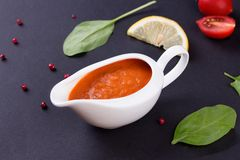 Fresh tomato sauce in the white sauce boat Royalty Free Stock Images
