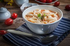 Fresh tomato soup with conchigliette stock photography