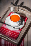 Fresh tomato soup in a white bowl. Royalty Free Stock Photography