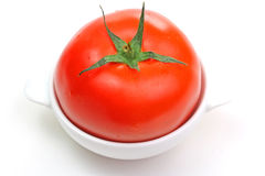 Fresh tomato in the white plate Royalty Free Stock Photography
