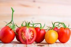 Fresh tomato on wooden background Stock Photo