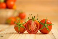 Fresh tomato on wooden background Stock Images