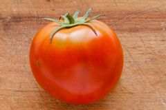 Fresh tomato on wooden board Stock Photo