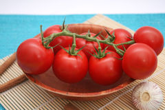 Fresh tomatoes. Some fresh tomatoes in a wodden bowl Royalty Free Stock Photo