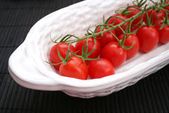 Fresh tomatoes. Some fresh tomatoes in a white bowl royalty free stock photography