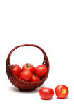 Fresh tomatoes. In a basket Stock Photos