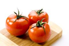 Fresh tomatoes. Isolated on white background Royalty Free Stock Photo